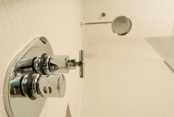 The main part of a shower faucet is behind the wall.