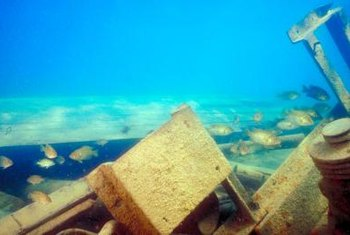 Marine salvage divers may help to remove wrecks that were discovered years after they happened.