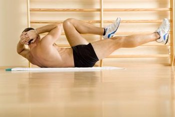 A mat makes bicycle crunches more comfortable on hard flooring.