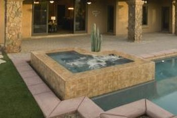 Stone veneers can be used as opposed to wood panels to wrap the base of your hot tub.