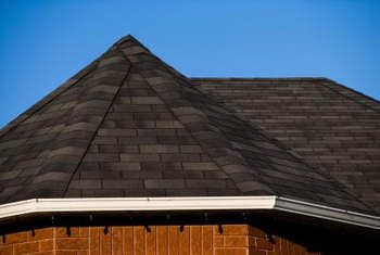 Asphalt roof shingles are among the least expensive products for roofing a home, but they can increase energy use in summer.
