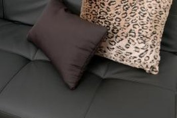Toss pillows can add color and texture to a black leather sofa.