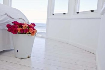 Repurpose an enamel bucket as a flower container.