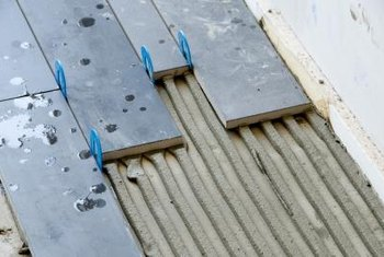 Cement-based products, such as thinset mortar, are ideal for humid conditions.