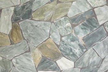 Irregular flagstones fit together like puzzle pieces for a natural looking hardscape.