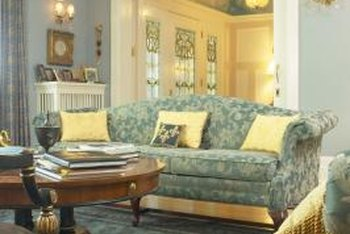 Teal upholstery is a beautiful choice for a sofa.
