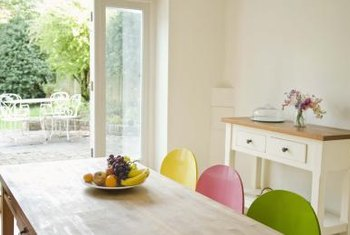 A dash of color prevents a white kitchen from looking institutional.