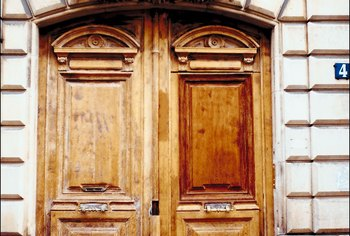 Refinishing a weathered door gives it a fresh look.