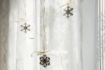 Make use of sparkling holiday ornaments as curtain tiebacks.