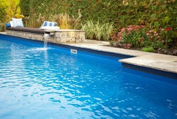 Move plants closer to the pool to integrate it with the landscape.