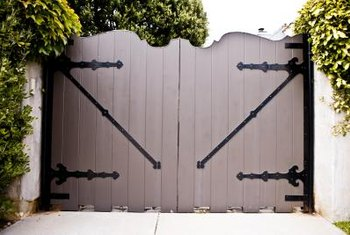 Diagonal, metal straps or cross members fastened to the gate add more support.
