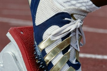 Olympic sprinters use running spikes when competing.