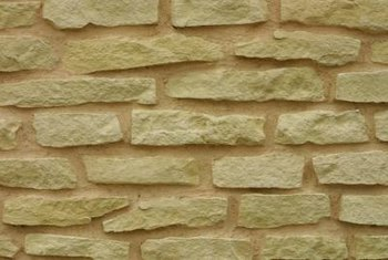 Stone walls on top of block walls are simply veneers.