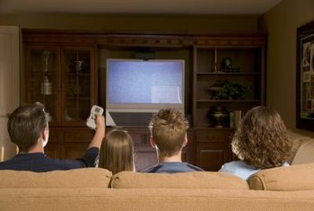 Home theater installers help family enjoy movies at home.