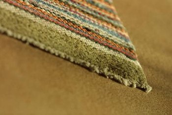 Repair the ends of your area rug to extend its useful life.