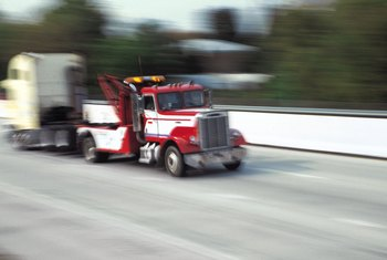Some tow truck drivers tow large vehicles, such as tractor-trailers.