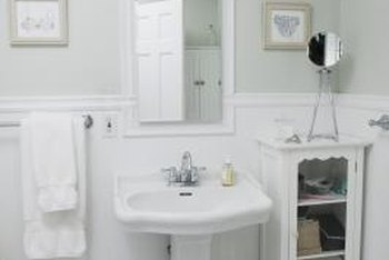 White beadboard heightens the visual interest for a humdrum bathroom.