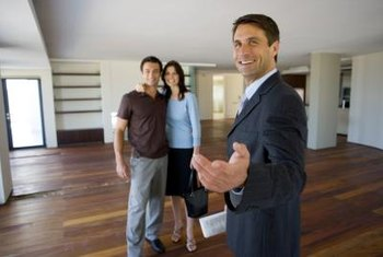 Apartment assistant managers show tenants available properties.