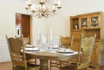 A round table often works better than a rectangular style in a two-walled dining room.