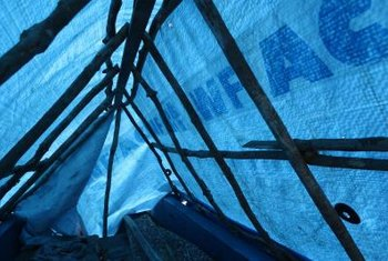 Tarps thrown over a greenhouse dramatically cool the inside temperature.