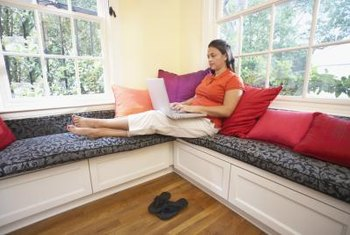 Make your window seat cozy with lots of homemade cushions.