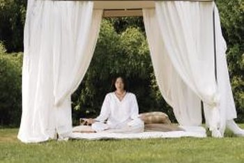 White or sheer curtains add an airy, inviting vibe to a pop-up gazebo.