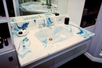 It's a simple task to repair small chips in faux marble sinks.