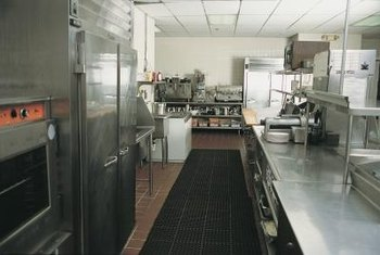 Certified technicians maintain food storage refrigeration units.
