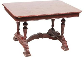 Mahogany tables add color and functionality to a dining room.