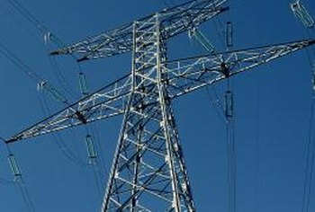 Electrical engineers may be hired to design transmission systems that utilize wires and towers.