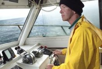 A cruise ship captain uses navigational aids to steer the vessel.
