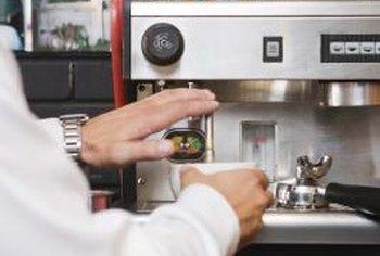 Baristas use the cup warmer on their espresso machines.