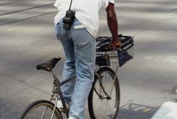 A bicycle courier manages deliveries in an urban environment.