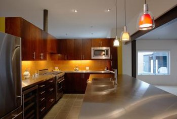 Kitchen islands are commonly illuminated by more than one chandelier or pendant light.