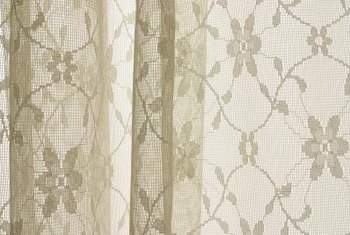 Lace curtains lie relatively flat so you can see their pattern.