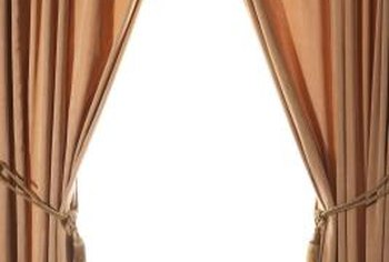 Curtains with rope and tassel tiebacks are classic formal window treatments.