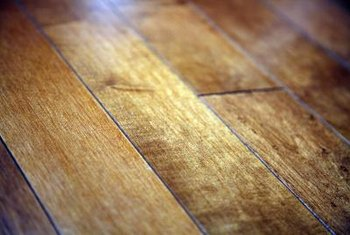 Hardwood flooring is covered with clear finish to protect it from most scrapes and abrasions.