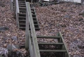 Outdoor wooden stairs collect algae and moss over time.