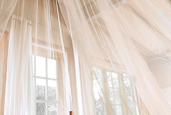 Add a canopy over your bed without drilling.