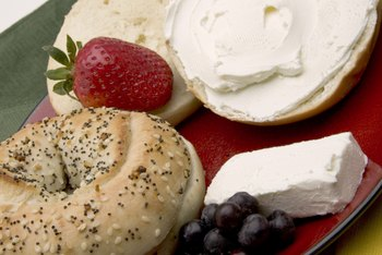 With between 35 and 47 grams of carbs, a bagel is not a low-carb accompaniment to cream cheese.