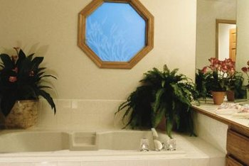 Contrasting trim makes an odd-shaped bathroom window stand out.