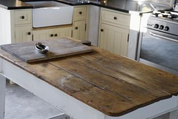 Use reclaimed barn boards as an authentic accent in an old farmhouse kitchen.