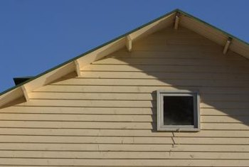 Sealing and painting Masonite siding prolongs its usefulness.