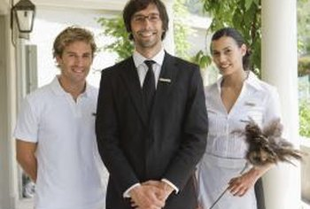 A hotel manager ensures the company hires skilled and competent workers.