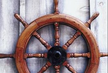 A navigation wheel and ship's lantern can spruce up a bare wall.