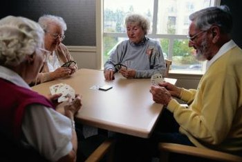 Activities assistants set up card games at retirment homes.