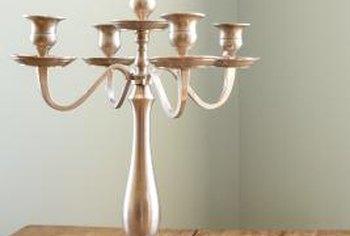 The elegant form of a silver candleholder shines without candles.