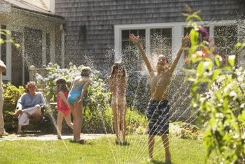Watering your lawn can be a simultaneous playtime event.