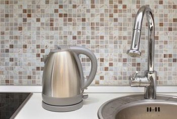 Build a portable backsplash using hardboard cut to fit the space.