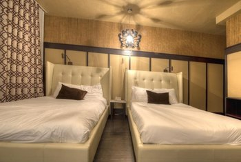 If these beds were arranged in an L-configuration against one wall, there'd be more floor space.
